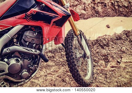 Pictures of motocross on the ground outdoors.