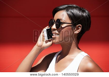 Young Beautiful Brunette Woman Blogger In Casual Style Clothes Talking On Her Cellphone, Smiling. Ha
