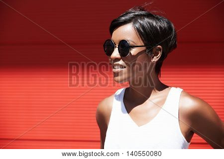Headshot Of Young African American Female Traveller Asking A Passer-by Which Way To Go To City Cente