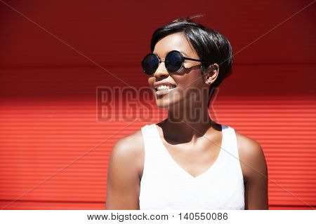Half Profile Of Young Attractive Dark-skinned Female With Fashionable Haircut, Dressed Casually, Loo