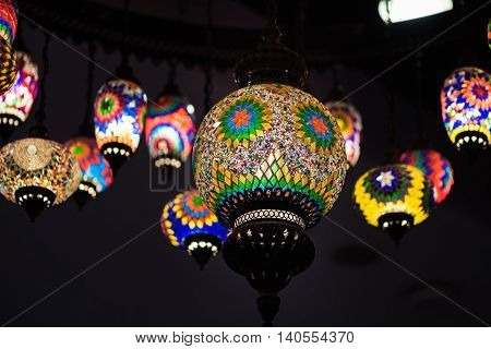 Close up of beautiful color retro arabiam lamp hanging on the roof.