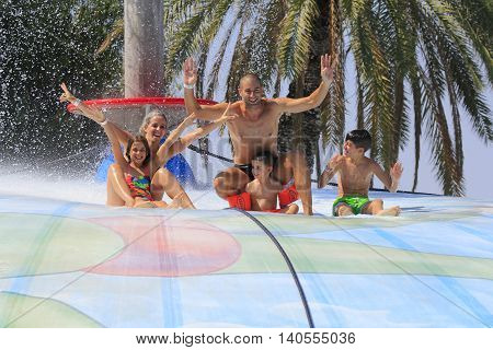 Rhodes Greece-July 23 2016:Family have a fun on the wet bubble in the water park .Wet bubble is one of many popular game for adults and children in Water park..Water Park is located on the island of Rhodes in Greece and one of the most
