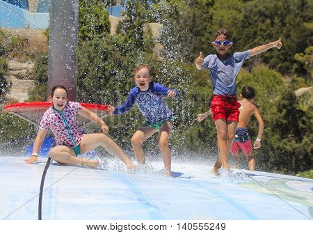 Rhodes Greece-July 24 2016:Cheerful group of child jumping on the wet bubble in the water park .Wet bubble is one of many popular game for adults and children in Water park..Water Park is located on the island of Rhodes in Greece