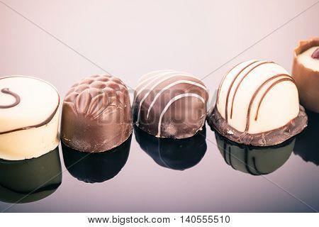 Chocolate Pralines On Dark Surface