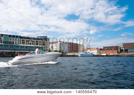 Copenhagen Denmark - July 22 2015: Panorama of the city seen from the main canal with a speedboat