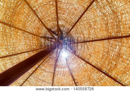 Bottom view on a wicker parasol on the beach in Egypt
