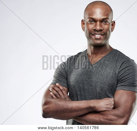 Cute Muscular Grinning Man With Folded Arms