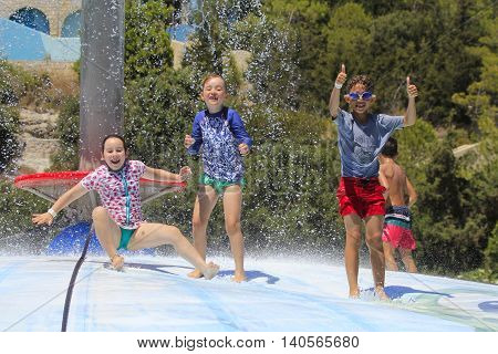 Rhodes Greece-July 25 2016:Cheerful group of child jumping on the wet bubble in the water park .Wet bubble is one of many popular game for adults and children in Water park..Water Park is located on the island of Rhodes in Greece