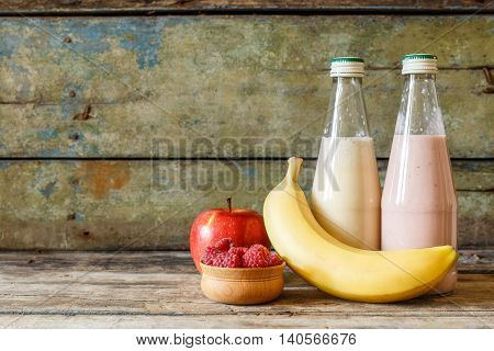 Two Bottles Of Fresh Smoothie With Ingredients