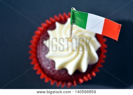Italian Republic Day cupcake with red white and green italian flag. National Liberation Day. Festa della Repubblica Italiana. Italy flag on cupcake. Focus on the flag.