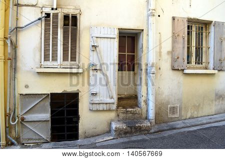 facade with lots of doors and windows of a typical french building