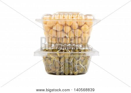 Germinated chickpea and lentil in a transparent plastic boxes isolated on white background