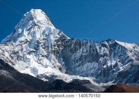 Summit of Ama Dablam from trekking route to Everest Pangboche Solukhumbu Nepal.