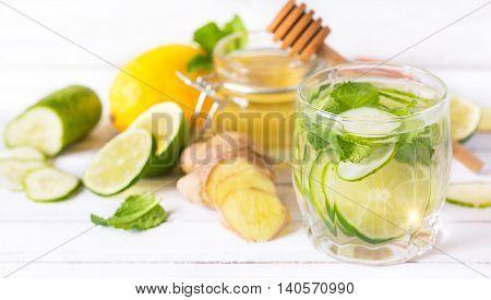 Organic detox drink and fresh cucumber, ginger, lime, lemon, honey and mint.