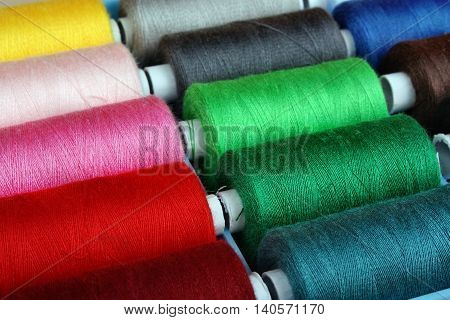 Colorful reels of threads background color manufacturing