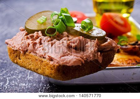 Sandwich with liver pate and pickles. Selective focus.