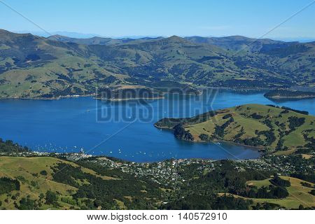 Akaroa Harbour and mountains. Landscape on the Banks Peninsula New Zealand. Bay town farmland and mountains.