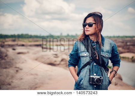Asian woman looking at nature In a relaxed mood