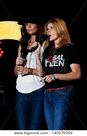 NEW YORK-SEPT 27: Actors Katie Holmes (L) and Connie Britton speak onstage at the 2014 Global Citizen Festival to end extreme poverty by 2030 in Central Park on September 27, 2014 in New York City.