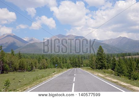 Tarmac road leading to the Sayan Mountains. Buryat Republic