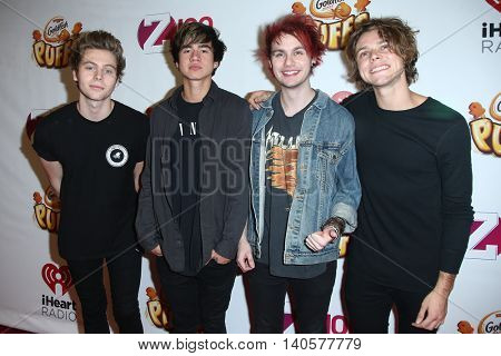 NEW YORK-DEC 12:(L-R) Luke Hemmings, Calum Hood, Michael Clifford and Ashton Irwin of 5 Seconds to Summer attend Z100's Jingle Ball 2014 at Madison Square Garden on December 12, 2014 in New York City.
