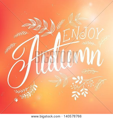vector illustration of hand lettering label - enjoy autumn - with doodle brunches and leaves.