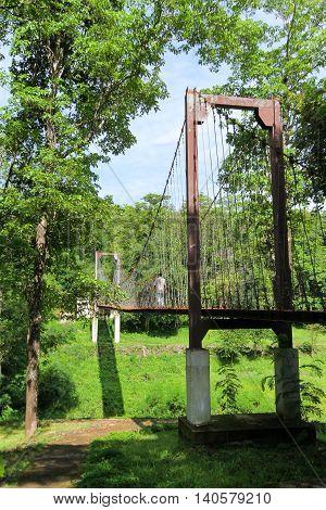 rope bridge or suspension bridge in forest at Khao Kradong Forest Park in Buriram ProvinceTHAILAND.