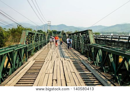 The well known bridge that situated above River Pai is popular spot for tourists to take a photo. March 31-2016 Mae Hong Son Thailand.
