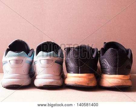 sports set of black orange sport shoes and blue sport shoe on sport background in concept family activity