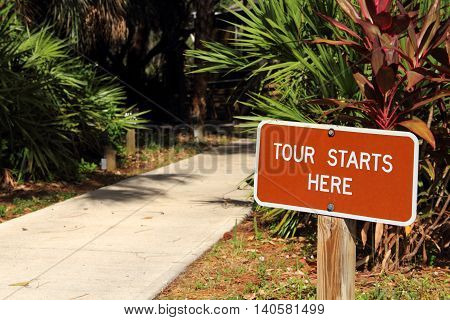 Tour Starts Here Sign at the Koreshan Historic State Park in Estero, Florida