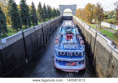 UGLICH, RUSSIA - SEPTEMBER 27, 2011: Passenger ship Lenin in the shipping lock of Uglich hydroelectric power station, Volga river