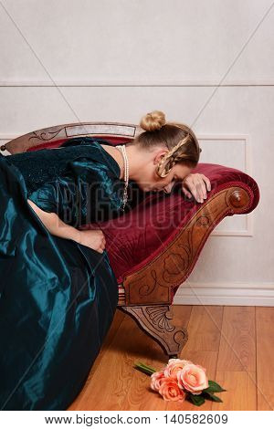 portrait of sad Victorian woman on fainting couch