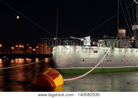 Cruiser Aurora on its Parking lot. Night St. Petersburg.