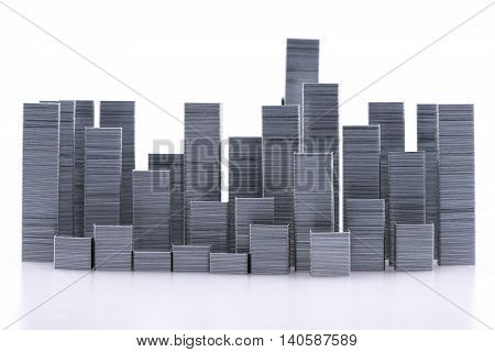Staples arranged to form city skyline on a white background