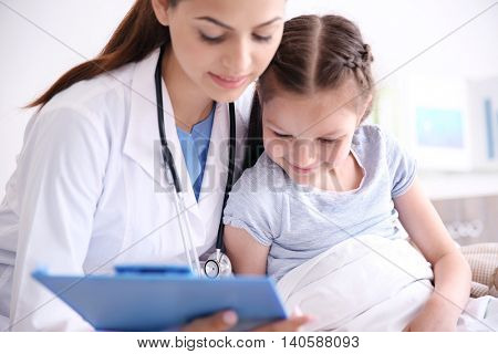 Cute girl visiting a doctor