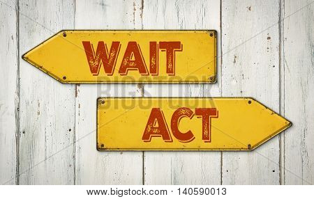 Direction signs on a wooden wall - Wait or Act