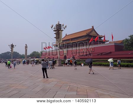 Beijing, China - June 08, 2016 Tourists and residents of Beijing prior to the Mausoleum of Mao Zedong on Tiananmen Square in Beijing.
