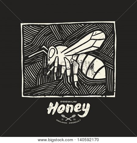 Stock vector linocut with a picture of bee and honey label. White print on black background