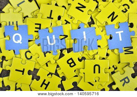 Puzzle pieces with word Quit