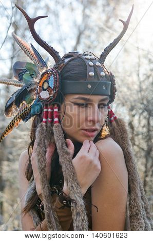 Modern Indian-style Girl In A Horned And Feathered Hat