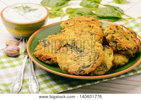 Vegetarian cuisine - fritters with potatoes and spinach.