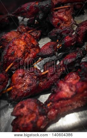 Restaurant style Chinese red chicken kebabs on serving tray