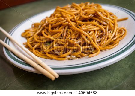 Chinese food vegetable plain lo mein noodles at restaurant