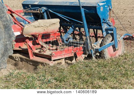 Sowing the field in use - closeup farming