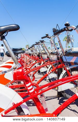 Red bicycle rental in Barcelona. Tour of the city on a bicycle. Spain.