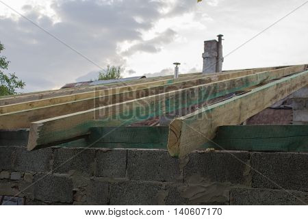 roof rafters against the sky black unfinished construction