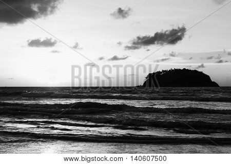 Seascape sunset with sunlight and storm cloud sky on the sand beach in twilight over light the sun black and white tone
