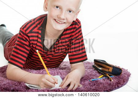 Smiling Young Boy Doing His Homework