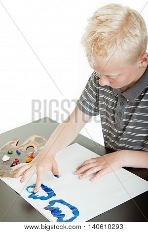 Little Blond Boy Having Fun Finger Painting