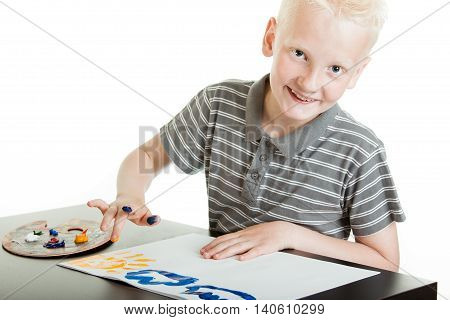 Friendly Little Boy Doing Finger Painting